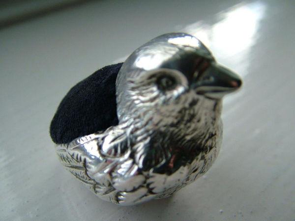 Pin cushion bird after