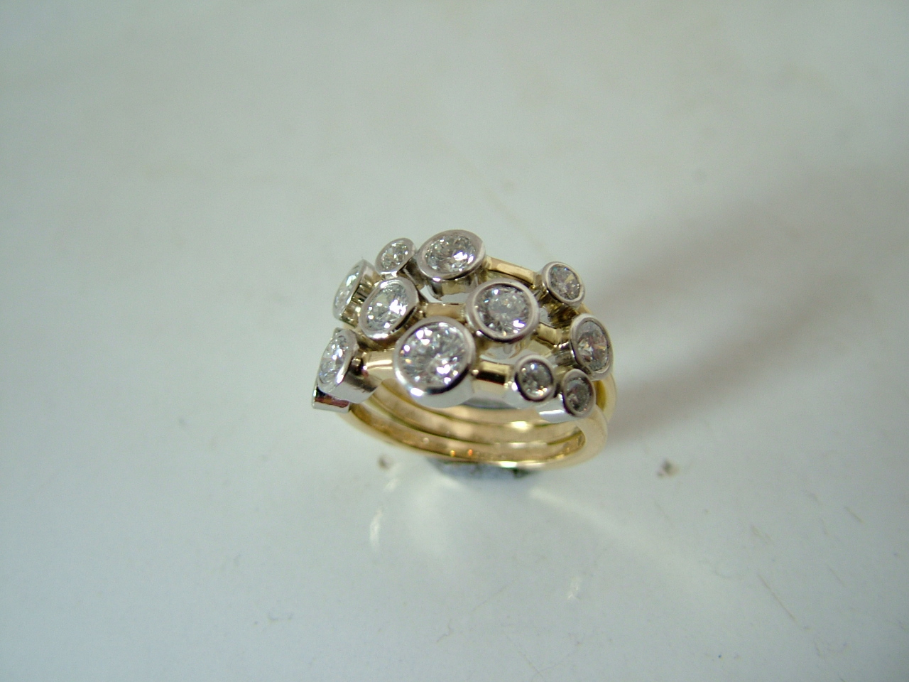 18ct yellow gold with diamonds set in platinum.