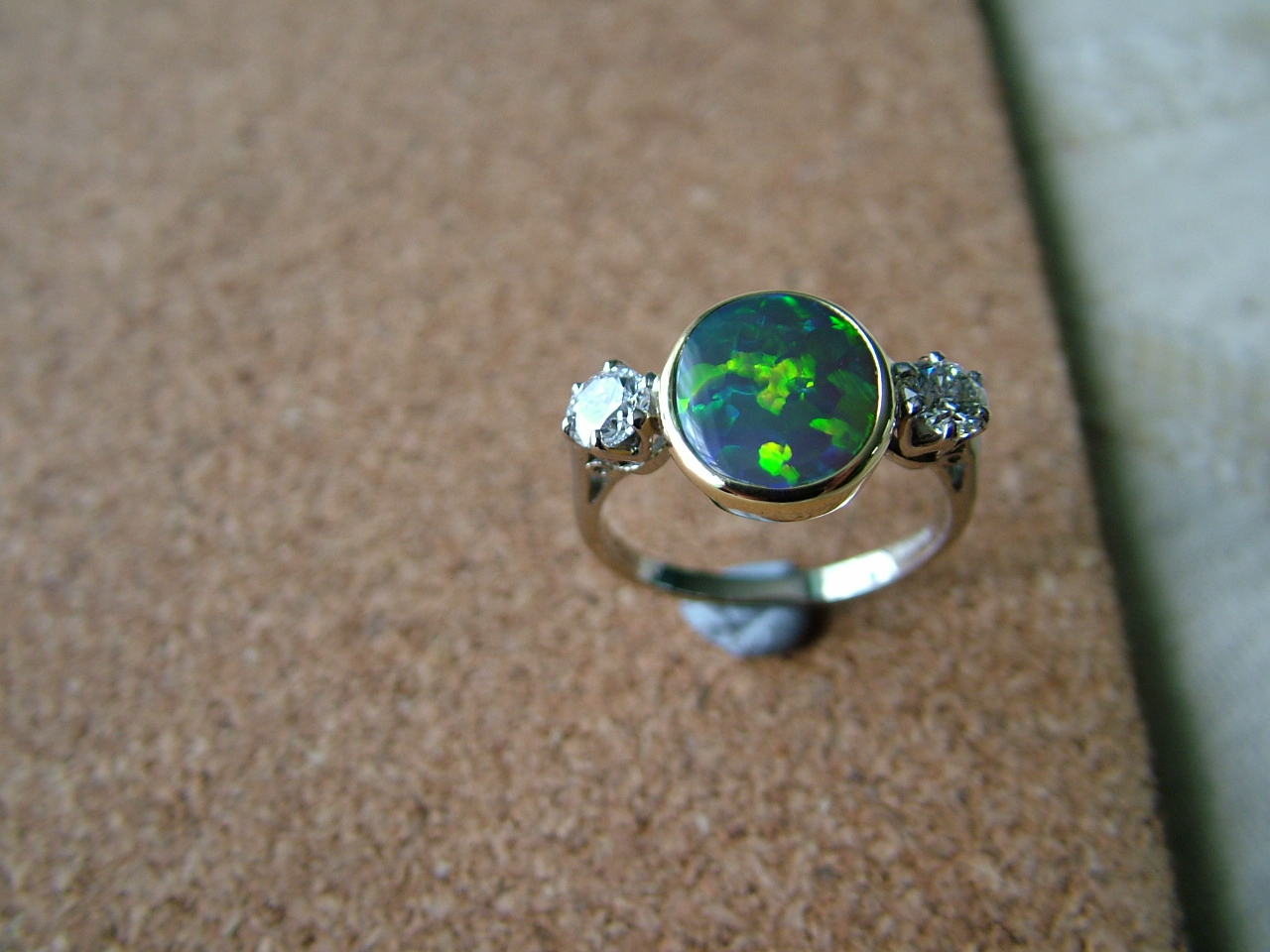 All18ct yellow gold opal and diamond ring