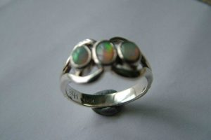 silver ring around stones